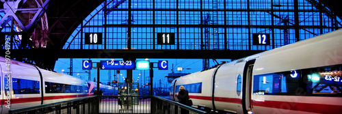 Obraz na płótnie Leipzig train station at night with two speed trains about to leave