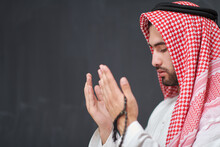 Arab Man In Traditional Clothes Praying To God Or Making Dua