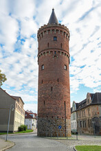 Fangelturm In Friedland (Mecklenburg-Vorpommern), Round Medieval Fortified Tower Built Of Brick, Formerly Part Of The City Wall, Also Used As Prison, Later As Water Tower And Today As Lookout Point