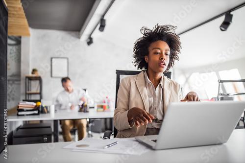 Business woman using modern technology.