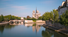 France, Ile-de-France, Paris, Long Exposure Of Seine Canal WithÔøΩNotre-Dame De Paris In Background