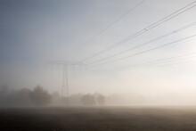 Germany, Brandenburg, Mahlow, Agricultural Field In Autumn Fog