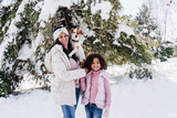 Smiling family with dog in snow at park