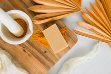 Bar Of Homemade Turmeric Soap With Ingredients