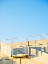 Yellow Footbridge Against Blue Sky