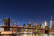 Magic hour view of Manhattan Skyscrapers and Brooklyn bridge in New York, USA