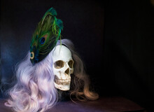 Photo Of Model Human Skull, With A Purple Wig And Vintage Hat.  The Photo Was Edited To Look Like An Oil Painting.