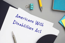 Juridical Concept About Americans With Disabilities Act With Phrase On The Piece Of Paper.