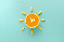 Abstract Idea.Top View Of Orange And Yellow Capsules On The Blue Background.Concept Of Healthcare And Vitamins