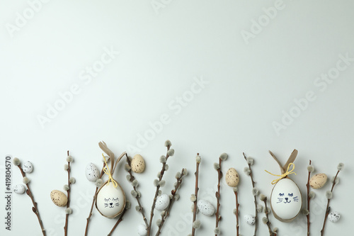 Fototapeta Easter eggs, quail eggs and catkins on white background