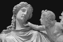 Antique Statue Of Eirene With The Infant Ploutos Isolated On Black Background. Goddess Of Peace Beautiful Young Woman Carrying A Cornucopia