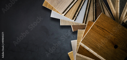 Obraz wooden texture flooring material samples on black stone background. banner copy space - fototapety do salonu