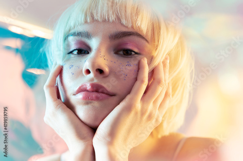Vászonkép Young blond teen girl with  smooth skin and modern fashion makeup  with sparkles on face