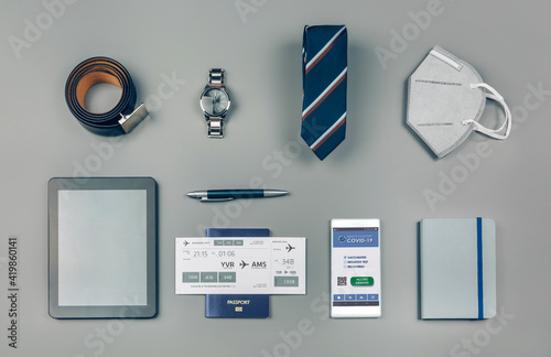 Background set with mobile covid passport and businessman trip accessories