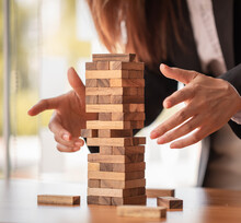 Abstract Businesswomen Fail Danger Tower Block Game Building Construction Protect Plan And Project Control.