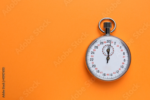 Obraz Vintage timer on orange background, top view. Space for text - fototapety do salonu
