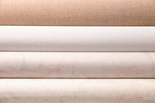 Different Wall Paper Rolls As Background, Closeup