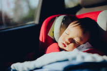 Portrait Of Toddler Boy Sleeping In Car Seat,Safety Car Seat