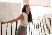 Asian Woman As Tourist In Andalusia Spain - Young Happy And Beautiful Korean Girl Relaxed On Street Balcony Enjoying Holidays Travel Walking Traditional Downtown Seville