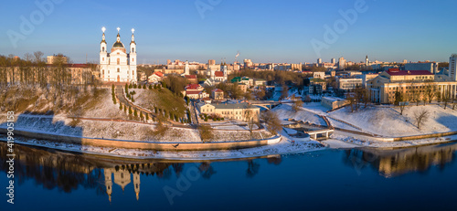 Fotografering Panoramic view of Dvina river and city of Vitebsk with cathedral orthodox church on the hill and oold town