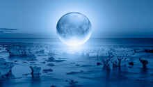 Full Glass Moon (or Crystal Ball Moon) Rising Over Empty Sea With Rock At Night