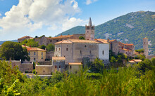 Plomin Croatia. View At Old Medieval Town With Vintage Roman Tower Clock. Picturesque Panorama Village Blue Sky And White Clouds.