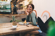 Happy Woman Enjoying Lunch In Modern Cafeteria