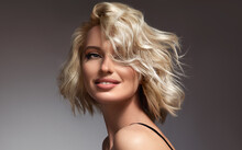 Beautiful Model Girl With Short Hair .Beauty Woman With Blonde  Curly Hair.  Hair Dye .Fashion, Cosmetics And Makeup