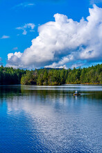 Fisherman On Thetis Lake With Reflective Sky, Greater Victoria, British Columbia, Canada