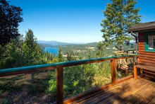 View From A Rustic Open Wooden Deck Overlooking Fernan Lake And Coeur D'Alene Lake In The Inland Northwest City Of Coeur D'Alene, Idaho USA.
