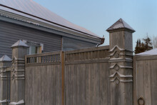 Details Of Finishing A Wooden Fence With Carved Pillars In The Provincial City Of Tobolsk (Siberia, Russia) On A Frosty Winter Morning. Lots Of Architectural Details And Beautiful Decorations