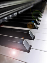 Soft Focus : Close Up Of Piano Keys. Side View Of A Musical Instrument With Lens Flare Filter.