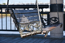 Outdoor Swing Bench In The Seating Pavilion At Waterfront Park In The Downtown Charleston, South Carolina Harbor.