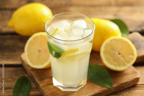 Cool freshly made lemonade in glass on wooden table, closeup Poster Mural XXL