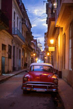 Amazing Old American Car On Streets Of Havana With Capitolio Building In Background During Night. Havana, Cuba.