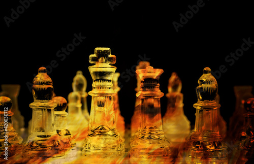 Carta da parati Double exposure: a chessboard made of glass pieces with a strong fire flame burning inside them