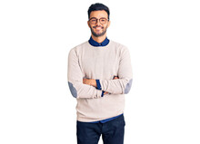 Young Handsome Hispanic Man Wearing Elegant Clothes And Glasses Happy Face Smiling With Crossed Arms Looking At The Camera. Positive Person.