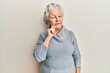 Senior grey-haired woman wearing casual clothes thinking concentrated about doubt with finger on chin and looking up wondering