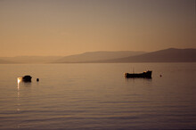 Two Small Boats Moored Off Largs On A September Evening, Scotland, UK, United Kingdom