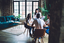 Young Diverse Colleagues Communicating In Modern Loft Office