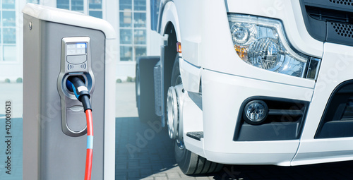 Fotografie, Obraz Electric vehicles charging station on a background of a truck