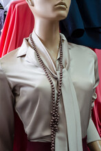 Silk Blouse With A Mannequin Collar. Long Beads And A Tie Around The Neck.