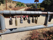 Locks On A Gate To Admit More Than One Agency Onto Trail Road