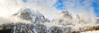 canvas print picture - Dolomite Mountains covered with clouds in winter. Panoramic view for the Brunecker Turm from Colfosco village.