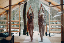 Woman Senior And Young Relaxing At Glamping Camping Tent Outdoor. Women Family Elderly Mother And Young Daughter Doing Yoga And Meditation Indoor. Modern Zen-like Vacation Lifestyle Concept.