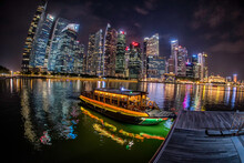 Boat Quay And The Singapore Skyline At Night.
