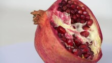 Spinning Half Of Pomegranate Fruit Close Up