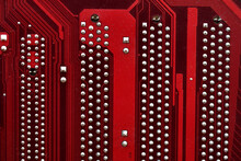 Red Surface Of The Motherboard Chip With Connectors