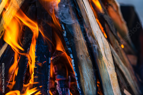 Canvas Print Burning wood chips to form coal