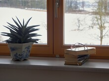 The Reader's Asylum Nook Behind A Window On A Gloomy Winter Day